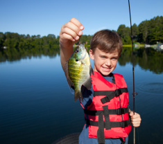 stock-photo-19347097-happy-boy-fishing.jpg