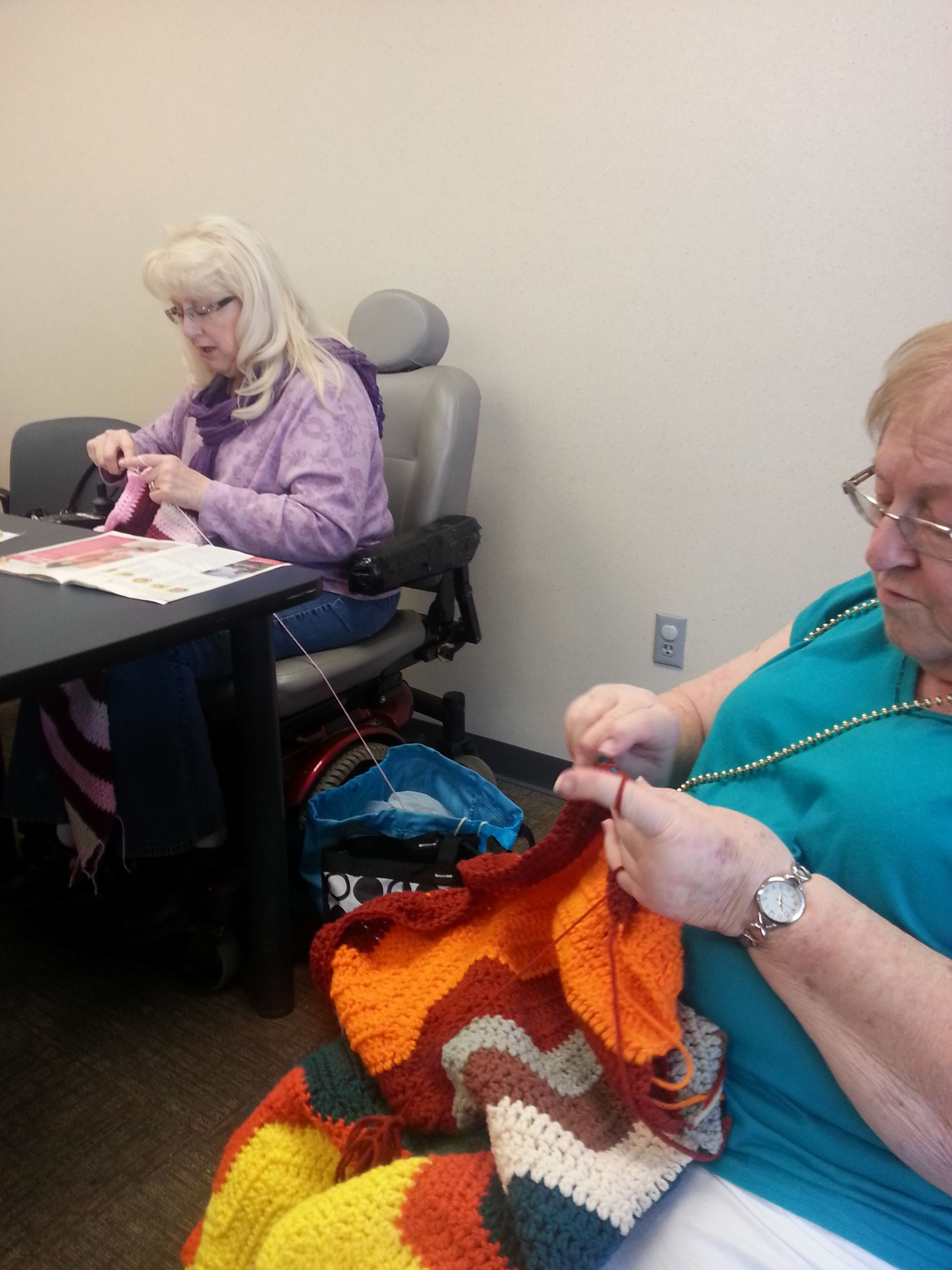 Crocheters making lap robes