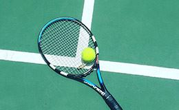 photo of a tennis racket on a tennis court