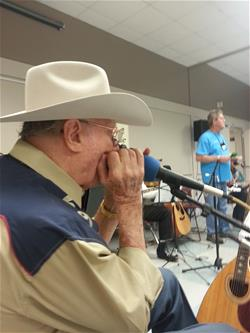 Buck entertains during the Jammers Session with his harmonica